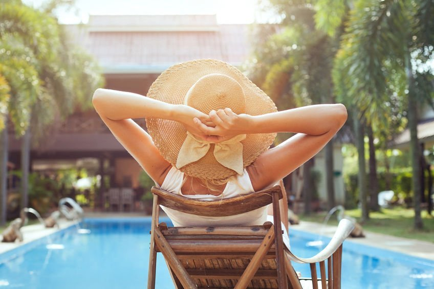 Woman relaxing near the pool.